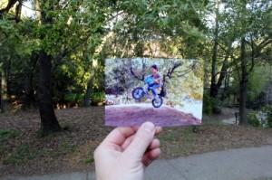 boy on a toy bike