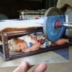boy sleeping under barbell